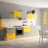 Un soggiorno con cucina a vista, asimmetrica e dalle tinte ...